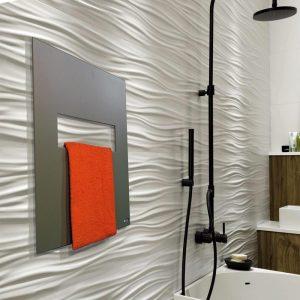 Radiador secatoallas VELA en baño moderno